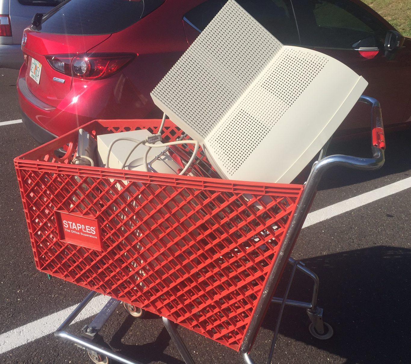 Shopping cart of old desktop computer, monitor and keyboard