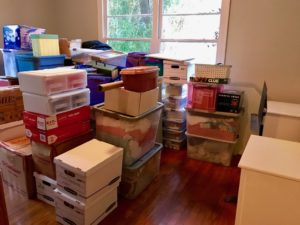 It's moving season! Here's an office filled with stacks of various moving boxes.
