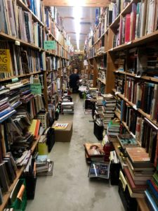 This image has an empty alt attribute; its file name is Chamblins-Bookmine-aisle-225x300.jpg