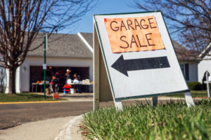 Garage sale sign in front of home