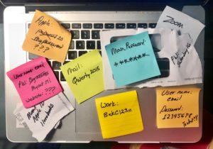 Colorful sticky notes on laptop keyboard