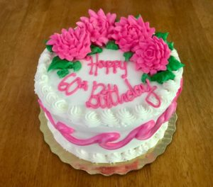 Round birthday cake with pink flowers